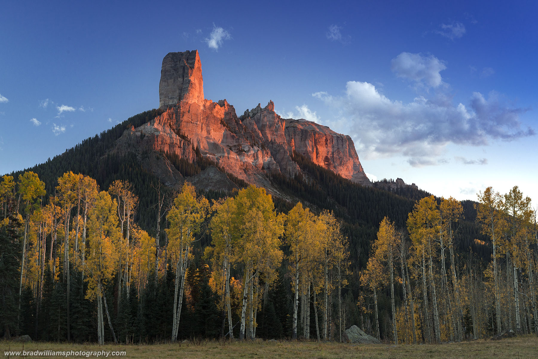 Its a great fall afternoon and suns warm glow is reflecting on the iconic Chimney Rock on the Owl Creek Pass in the Uncompahgre...