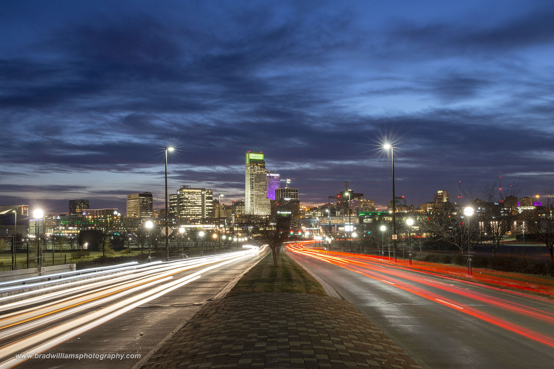 A beautiful sunset from the gateway to Omaha, Nebraska.  The Downtown Skyline as seen from Abbott Drive.